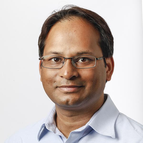 Portrait of Dr. Vivek Kumar against a white background
